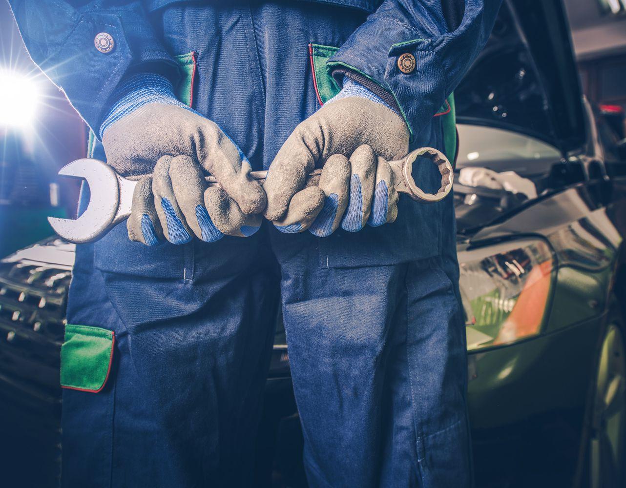Car Mechanic doing a Car Service - Car Servicing Plympton