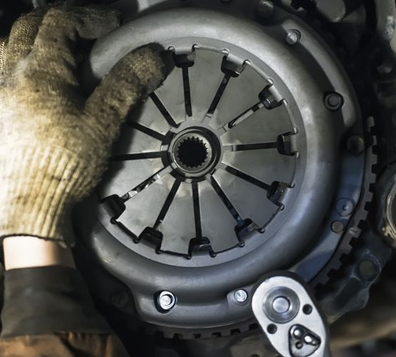 Mechanic performing diagnostics on a car - Car Repairs Plympton